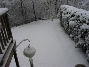 Click to enlarge: snow-covered lawn, bird feeder, etc.